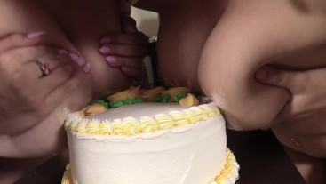 Alix Lovell and Alice Frost smash a cake with boobs