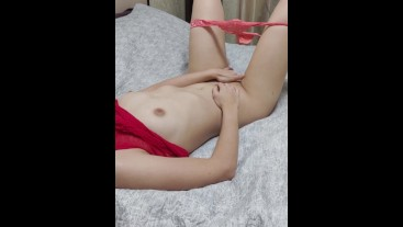 Sexy girl caresses herself and her wet pussy and ends up with a bright orgasm
